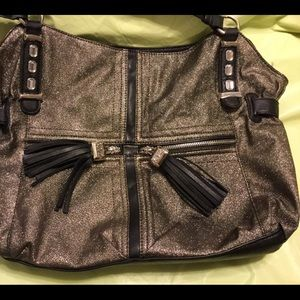 Gold sparkly shoulder bag from Kathy. Black trim.